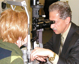 Dr Tayfour diagnosing a cataract
